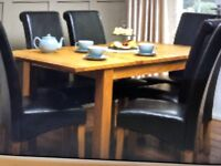 Oak extending table with 6 leather chairs