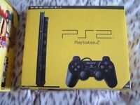 Near mint SUPER SLIM PS2 Console Boxed. + Buzz controllers game and outer bundle box