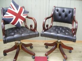 Stunning Pair of Black Leather Chesterfield Captains Chairs.