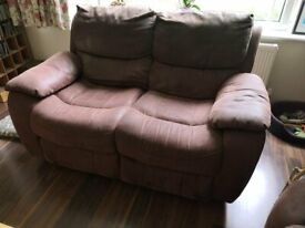 Pair of brown faux leather comfortable reclining sofas in very good condition