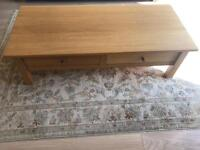 Solid oak coffee table with 2 storage drawers - great condition