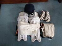 Junior Cricket Gear including helmet, pads, gloves, leggings and jumper