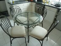 Glass Topped Metal Table and Four Chairs