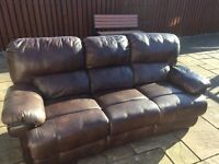 Large brown leather manual recliner sofa.