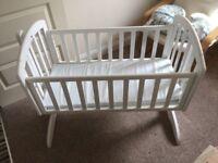 Beautiful white rocking crib