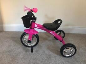 Kiddo pink three wheeler bike