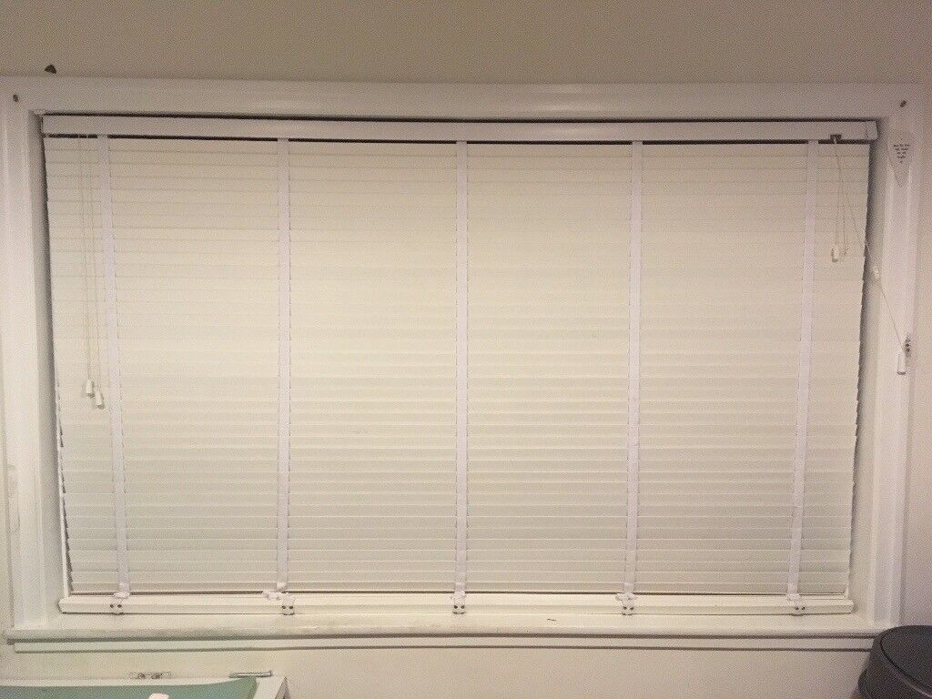 White wooden blind with tapes
