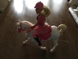 Barbie doll with moving horse