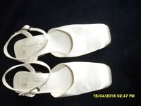 A Pair of White sling back Satin shoes