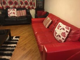 3 X 2 red and black DFS sofa