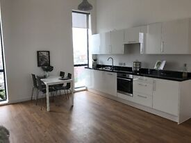 Luxury one bedroom apartment with a balcony and a parking space to rent in X1 Aire in Leeds
