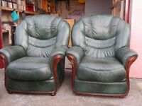 Two matching green leather armchairs made in Italy