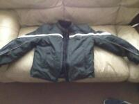 Triumph motorcycle jacket with body armour.