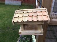 Hanging wooden garden bird feeder
