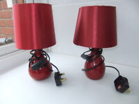 pair of bedside lamps in red with switch and bulb