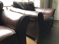 Two brown leather M&S armchairs