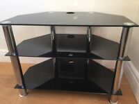 Black and Chrome corner television Stand. Glass shelving 75cm wide , excellent condition .