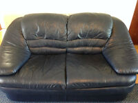 Two 2 seater leather sofas and leather armchair, in dark navy blue, in good condition