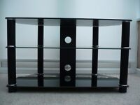 Black tempered glass TV stand in excellent condition. 80cm(w) x 40cm(d) x 48cm(h). front or corner.