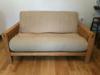 Two seat solid oak frame futon/sofa bed by Futon Company, 'OKE' range with mattress and cover