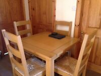4 seater wooden dining table and chairs
