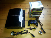 Playstation 3 with 320GB hard drive + 14 games