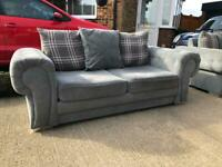 Matching grey Chesterfield sofas