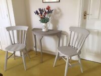 Four beautiful solid dining chairs painted in Autentico Bath Stone Chalk Paint