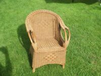 child`s wicker chair suitable for young child