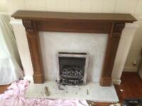 Marble fire place and wooden surround