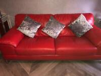 Red leather couch and 2 swivel chairs