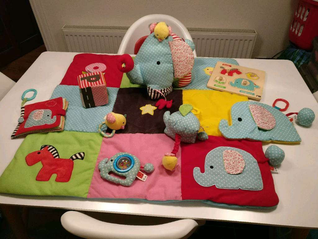 Baby playmat (mothercare) with toy arch and various matching toys.