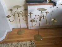 Pair of large gold candelabra