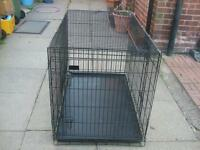 Large dogs cage. Two doors and a pull out tray easily collapsed