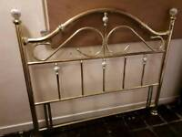 Brass headboard suits king size bed