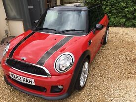 Red Mini Cooper diesel with a John cooper works Chilli pack