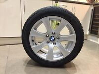 A set of 4 alloy wheel trims with snow tyres
