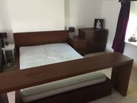 Dark wood double bed from ikea