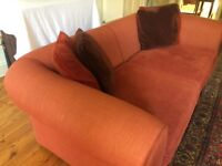 A superb large luxurious sofa, in worsted and velvet rust-red Colefax & Fowler fabric