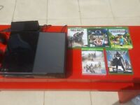 Xbox One with 7 games incl 30in1 game and 2 controllers