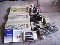 Three commodore 64's with accessories and games