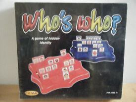 WHO'S WHO, ( Guess who type board game) by Feva / Spin Master games. Sealed.
