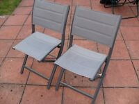 Two Fold able Grey Chairs - Used less than a handful of times - Some original packaging remains on