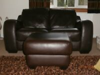 Two seater Italian leather sofa and footstool for sale