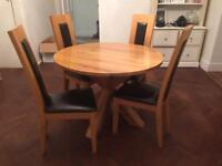 Large round solid oak table and 4 dining chairs