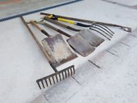 A Selection of used garden tools.