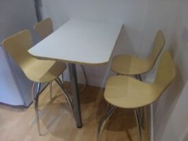 4 Bar Kitchen stools - light wood swivel seat and chrome legs in good condition.