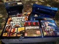 Playstation 4 500GB + Playstation TV + Camera & 3 Games.