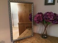 Ornate antique silver mirror with beveled edge glass