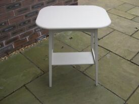 An oak table painted pale grey and with under tier.